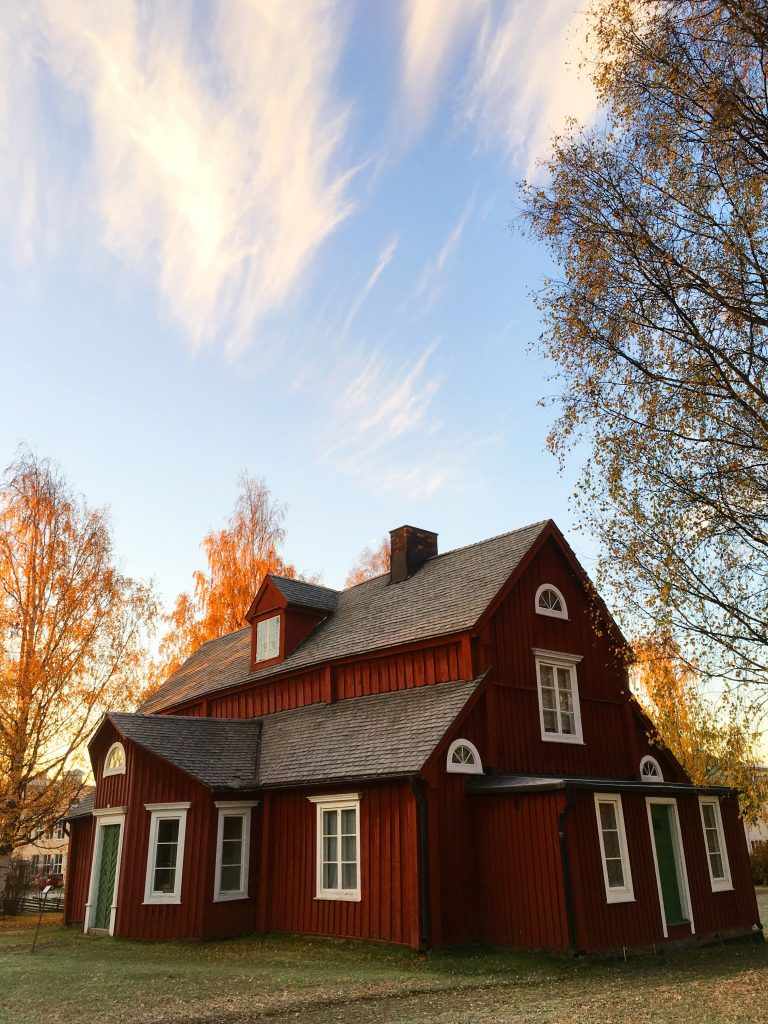 red house with shingled roof