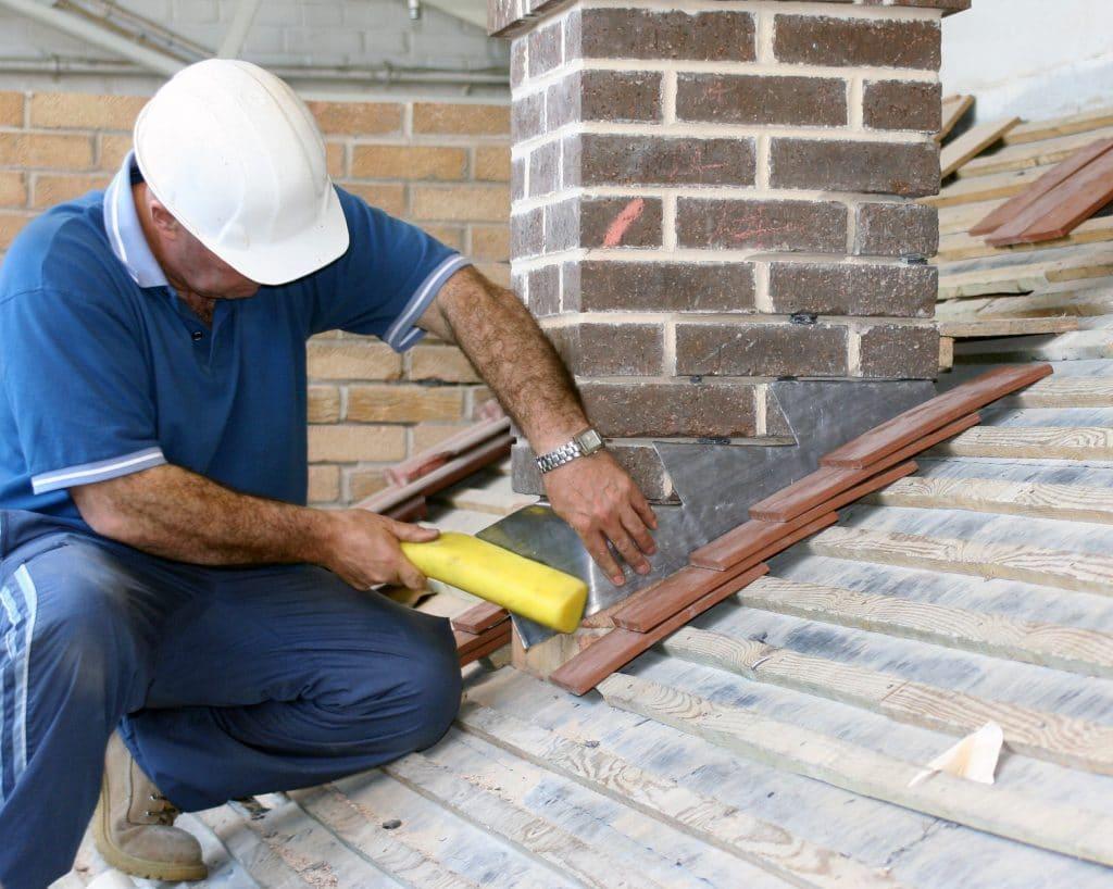 Roof flashing installation around chimney