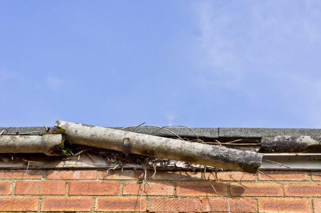 Broken gutter with debris